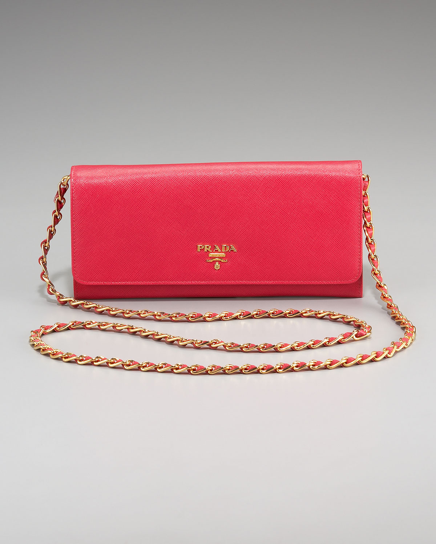 23517a2f012e ... low price prada saffiano chain crossbody wallet in red lyst 8b0f5 90332