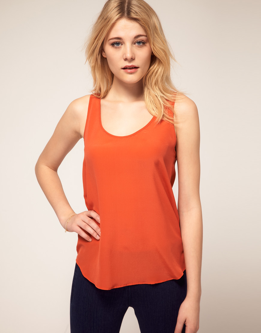 Plus Size Camisoles & Sleeveless Tops Camisoles – tanks, shells, camis. Whatever you want to call them, they're a must-have in a woman's wardrobe. Plus size camisoles are perfect to pair with a light jacket, dark jeans and heels for a night out, or under a wrap dress or v-neck sweater to provide a bit more coverage in the bust for work.