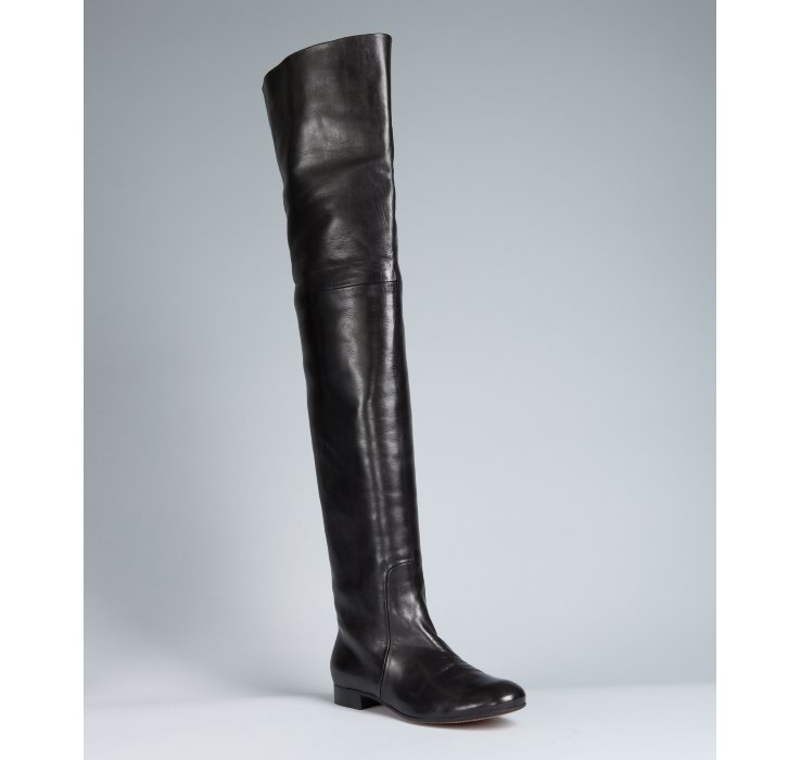 black leather thigh high flat boots in black lyst