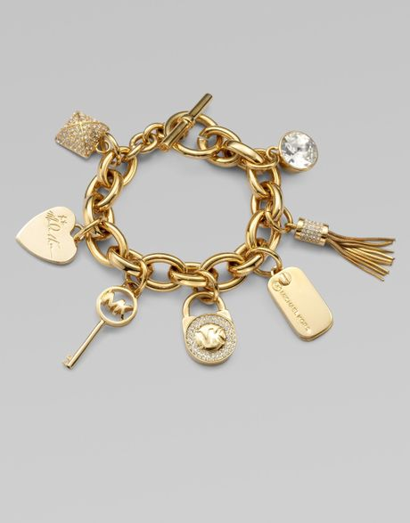 michael kors accented charm bracelet in gold lyst