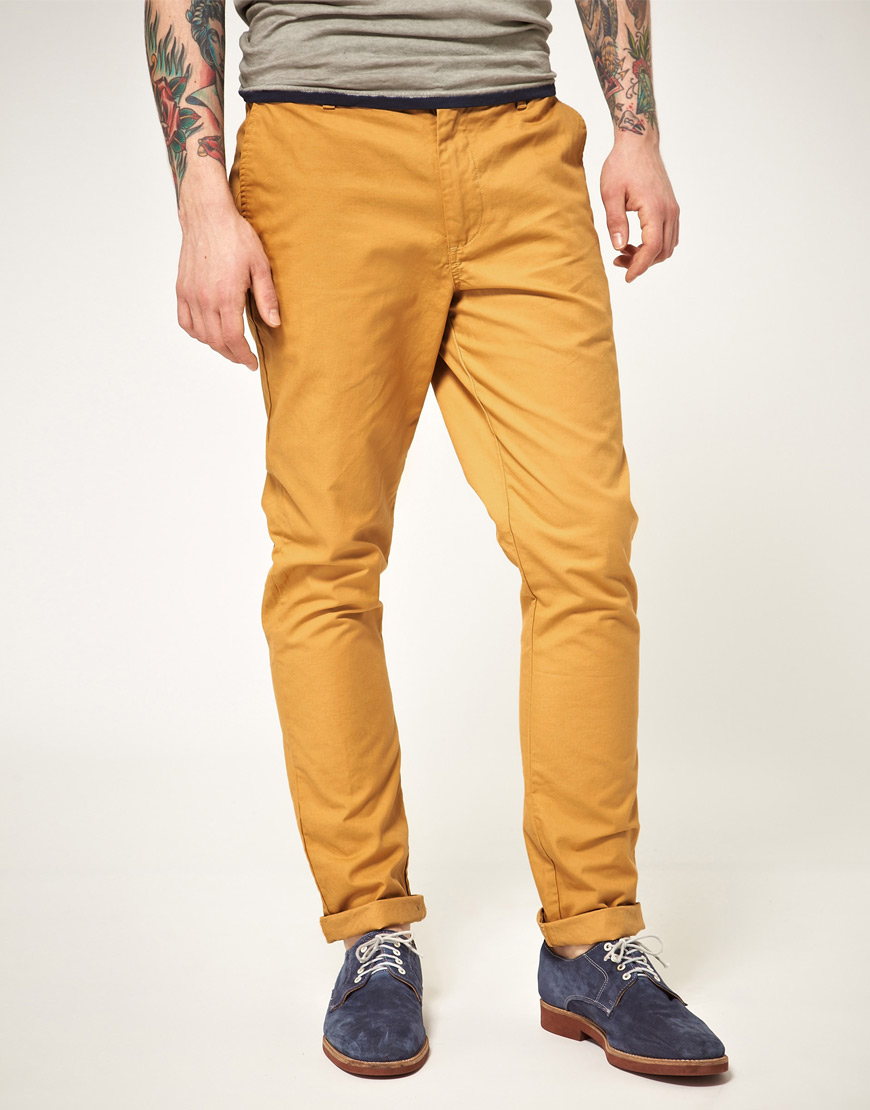 CHINOS. If mustard is associated to any item of clothing in our wardrobe, it is without doubt the chino. No matter the season this is the one time men actually wear mustard without feeling self conscious about the colour they are wearing.