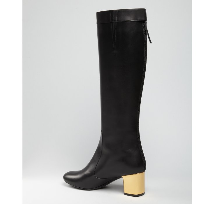 Céline Black Leather Gold Heel Tall Boots in Black | Lyst