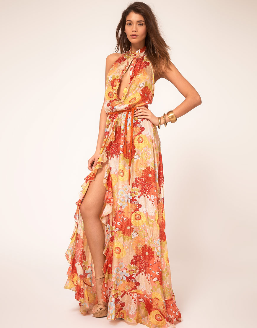 Details: A floral print maternity maxi dress. V-neckline. Cinched under bust. Sash tie. 3/4 sleeves. It will be impossible not to catch everyone's eye in this vibrant, feminine maternity maxi dress!