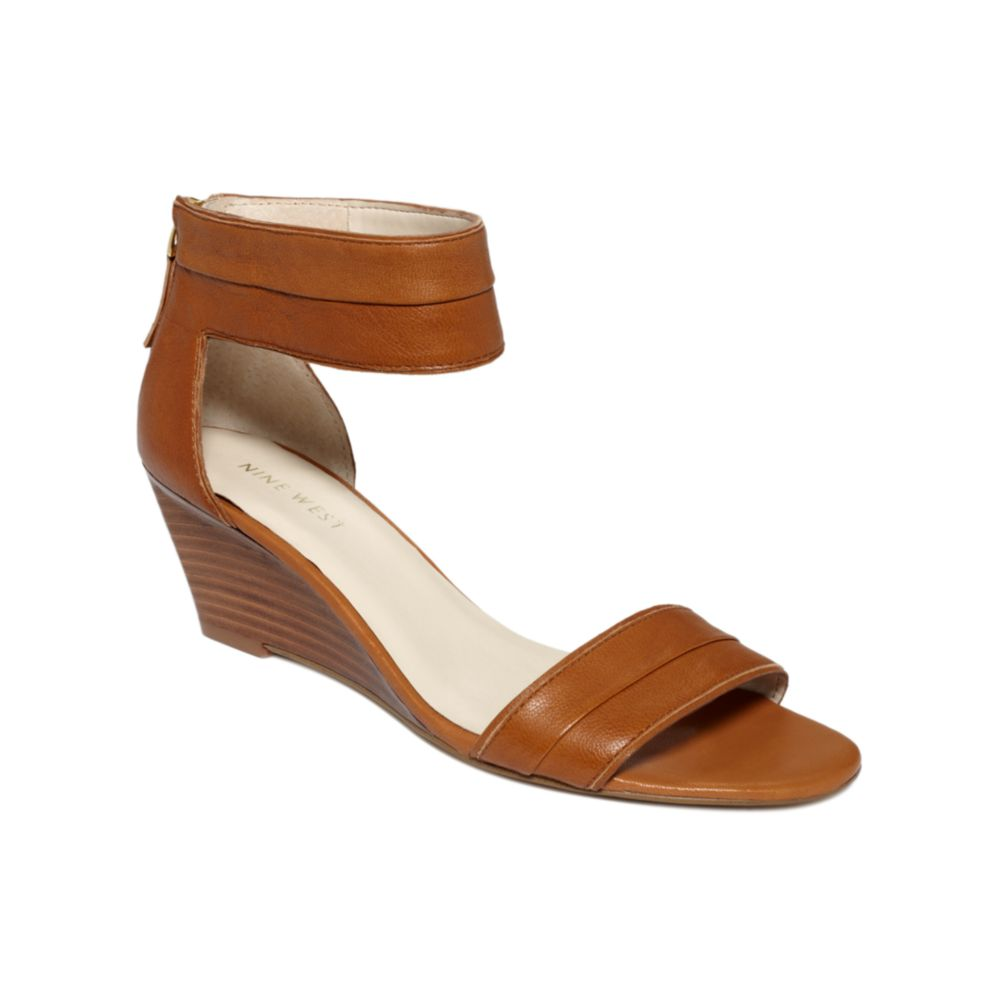 nine west packpunch wedge sandals in brown lyst