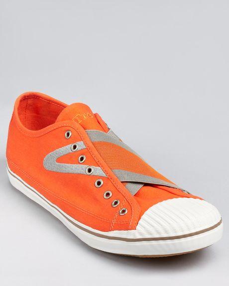 tretorn skymra canvas slipon sneakers in orange for