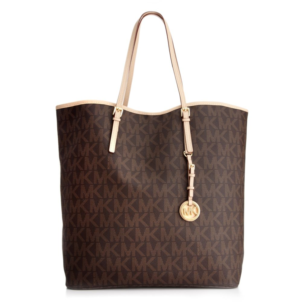 1a7e62a59950c Lyst - Michael Kors Jet Set Travel Signature Large Ns Tote in Brown