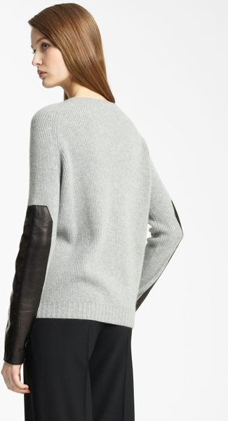 Buy MILLY Women's Black Leather Sleeve Sweater. Similar products also available. SALE now on!