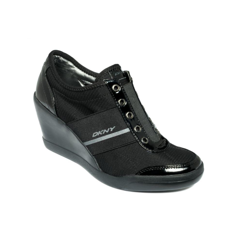 ca8d334711ed Lyst - DKNY Darcy Wedge Sneakers in Black