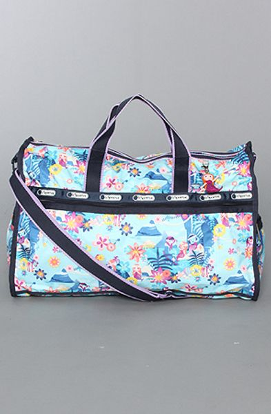 Lesportsac The Disney X Lesportsac Large Weekender Bag with Charm in Tahitian Dreams in Blue