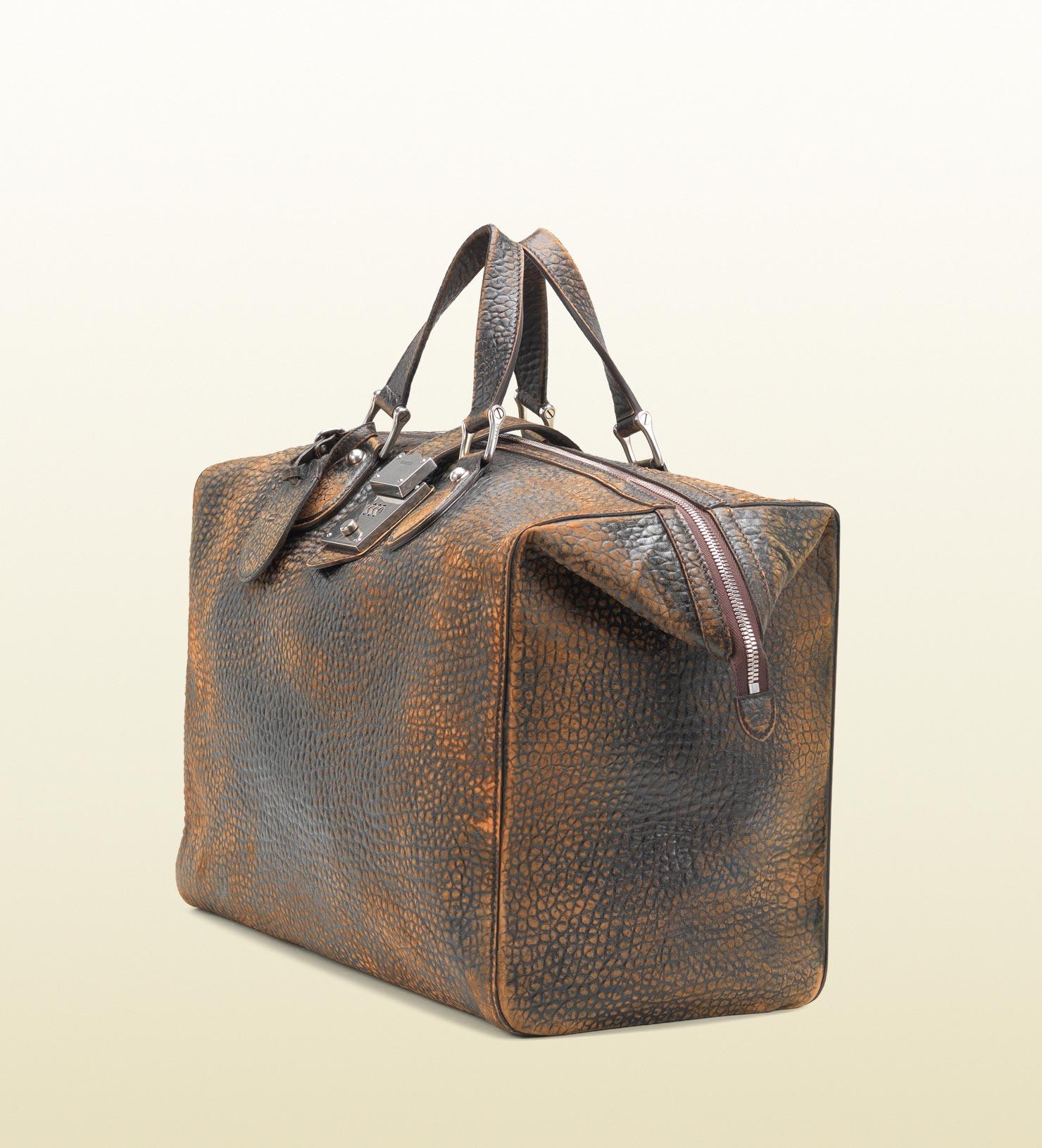 Gucci Gucci men goldmark grainy leather duffle bag Men39s bags 0b7592791f