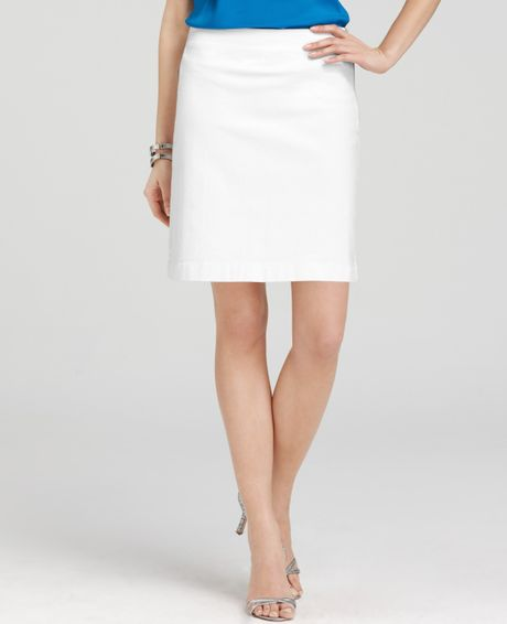 stretch denim mini skirt in white lyst
