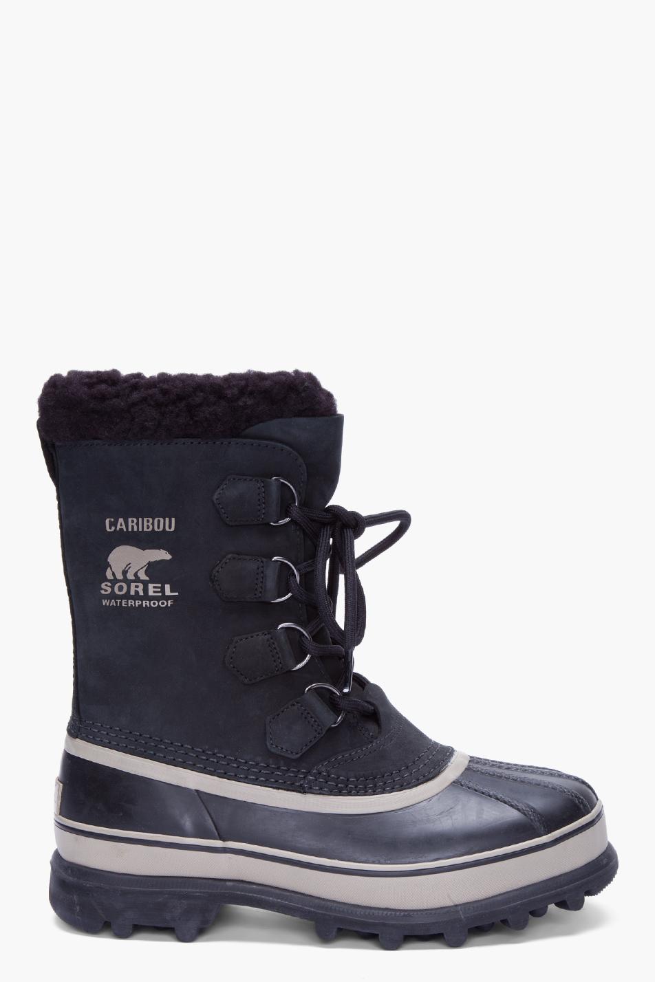 sorel black nubuck caribou boots in black for lyst
