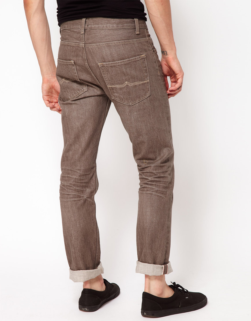 Everyone knows the best pair of cheap men's jeans comes from Levi's, but there are plenty of other cheap jeans in the sub $ space that are worth considering. Whether you're interested in selvedge or raw, straight or skinny, navy or black, or just a new pair of beaters you don't have to worry about getting dirty, there are great cheap jeans for men out there.