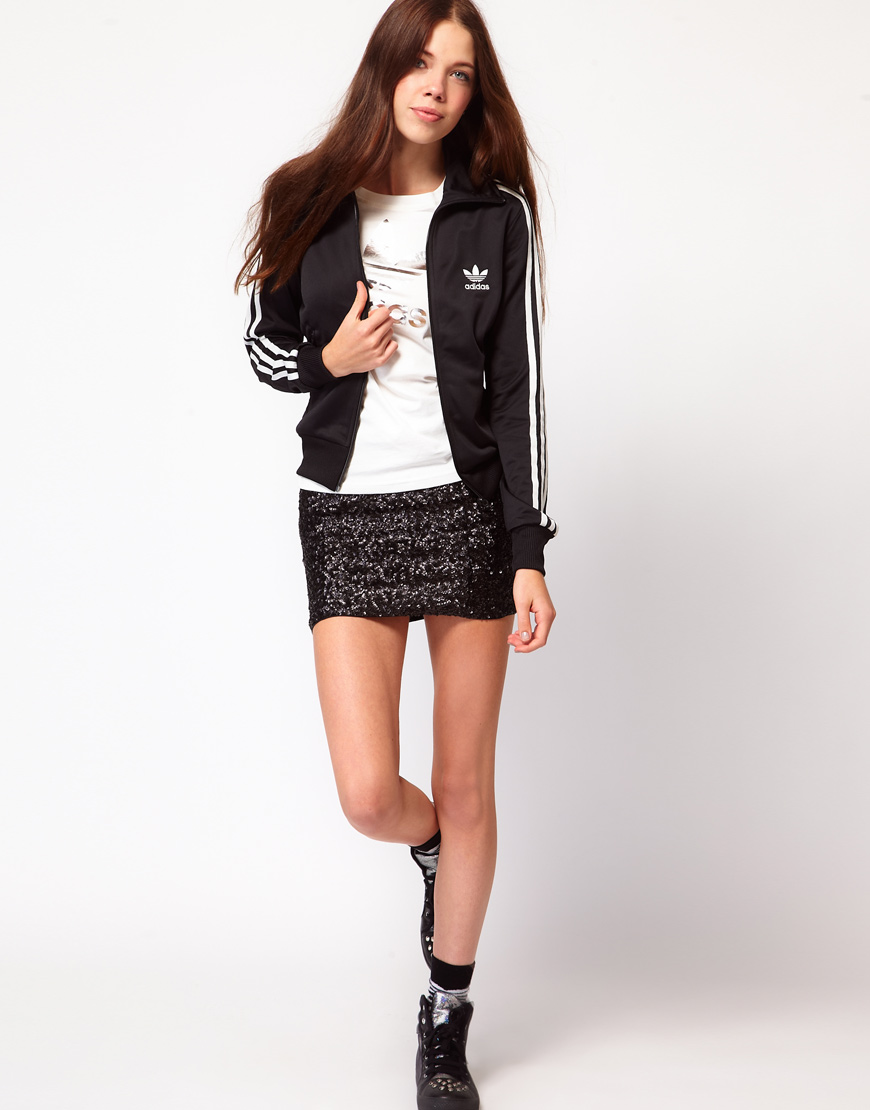 lyst adidas firebird track top in schwarz