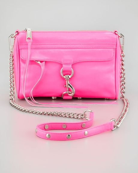 I wear my Rebecca Minkoff watch every day – it has a large round, hot pink face, perfect for a quick glance that's eye-catching. The Tesla showroom in the Meatpacking District of Manhattan.