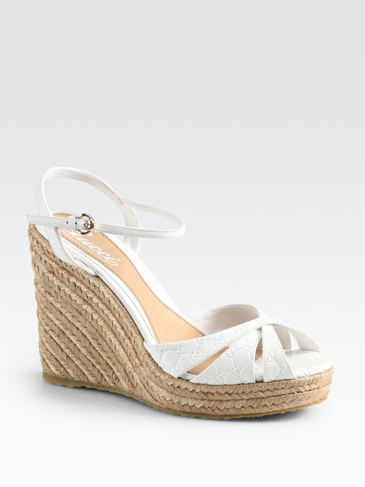 9078d43f4204 Lyst - Gucci Penelope Gg Leather Espadrille Wedges in White