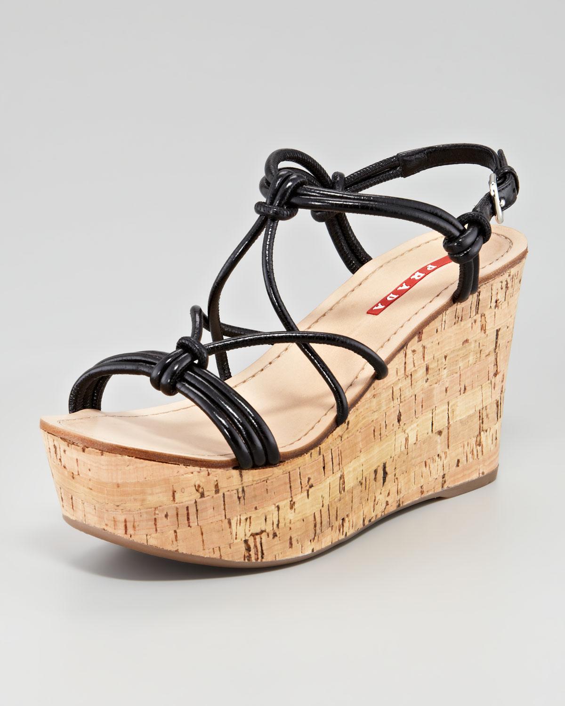56f5f041f05 Lyst - Prada Strappy Knot Cork Wedge Sandal Black in Black