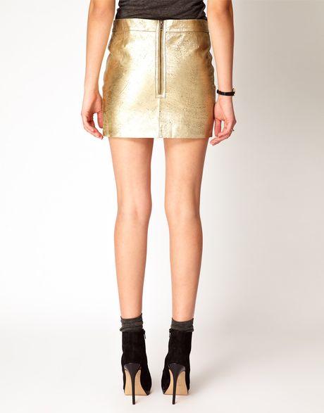 ganni leather mini skirt in gold in gold golden lyst