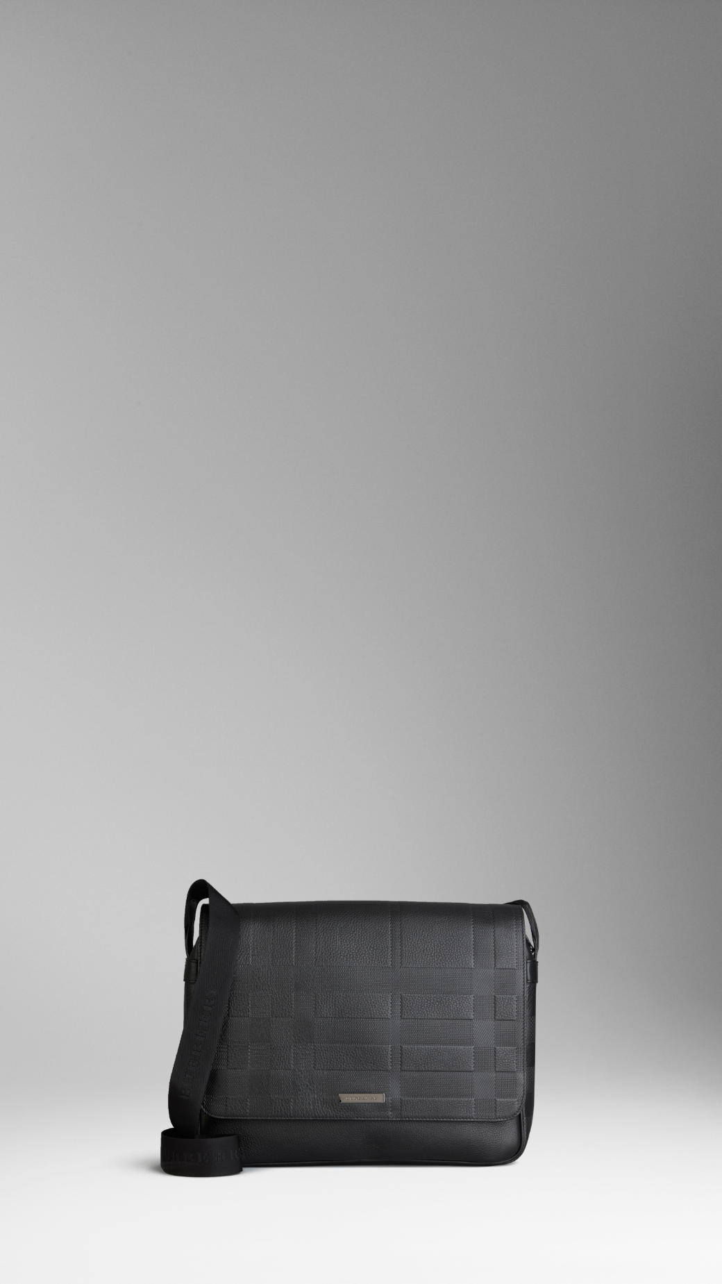 fd125c82dd Lyst - Burberry Large Embossed Check Leather Messenger Bag in Black ...