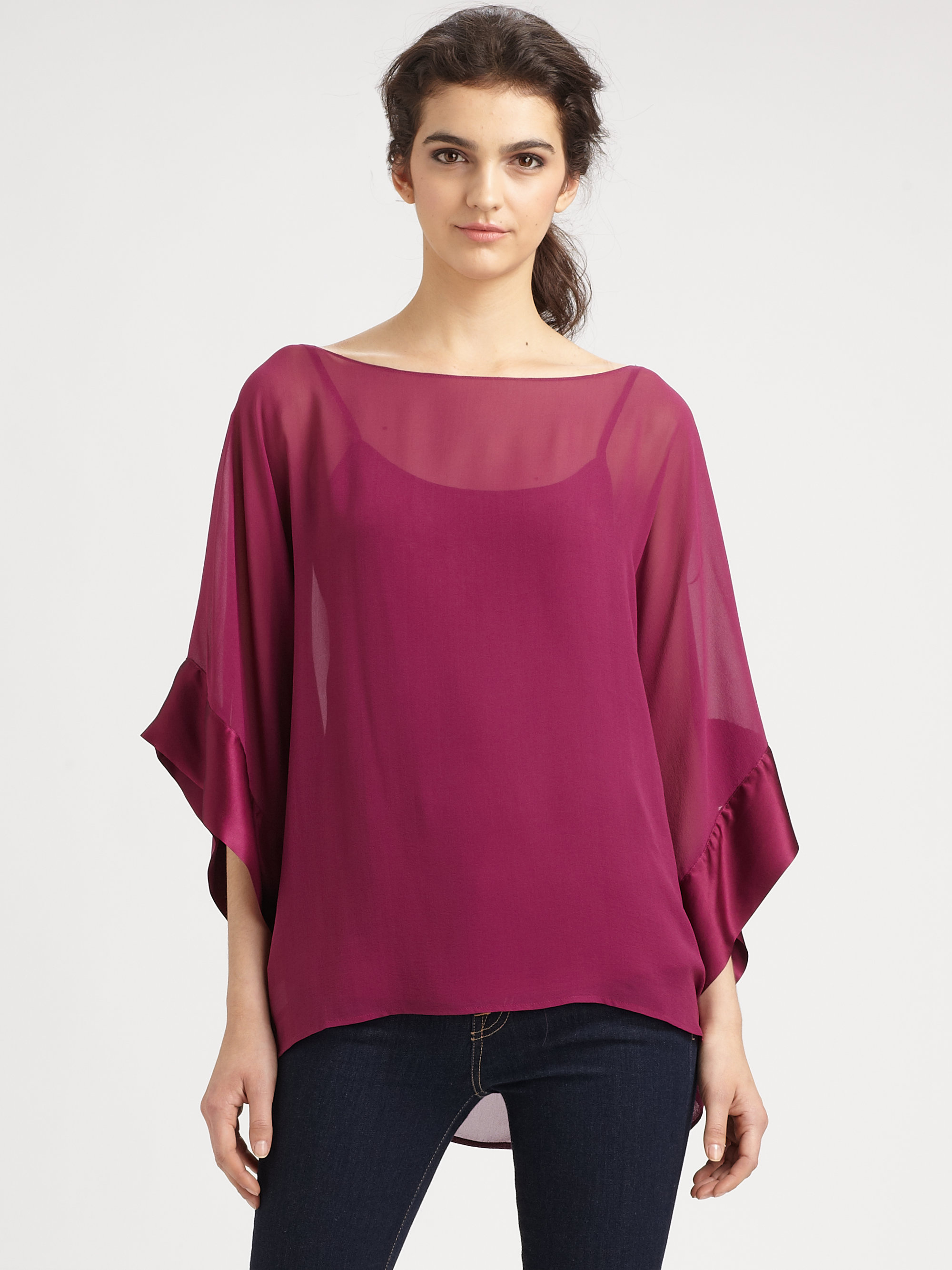 Product Features Lightweight fabric with great stretch for comfort / Loose fit dolman sleeve top.