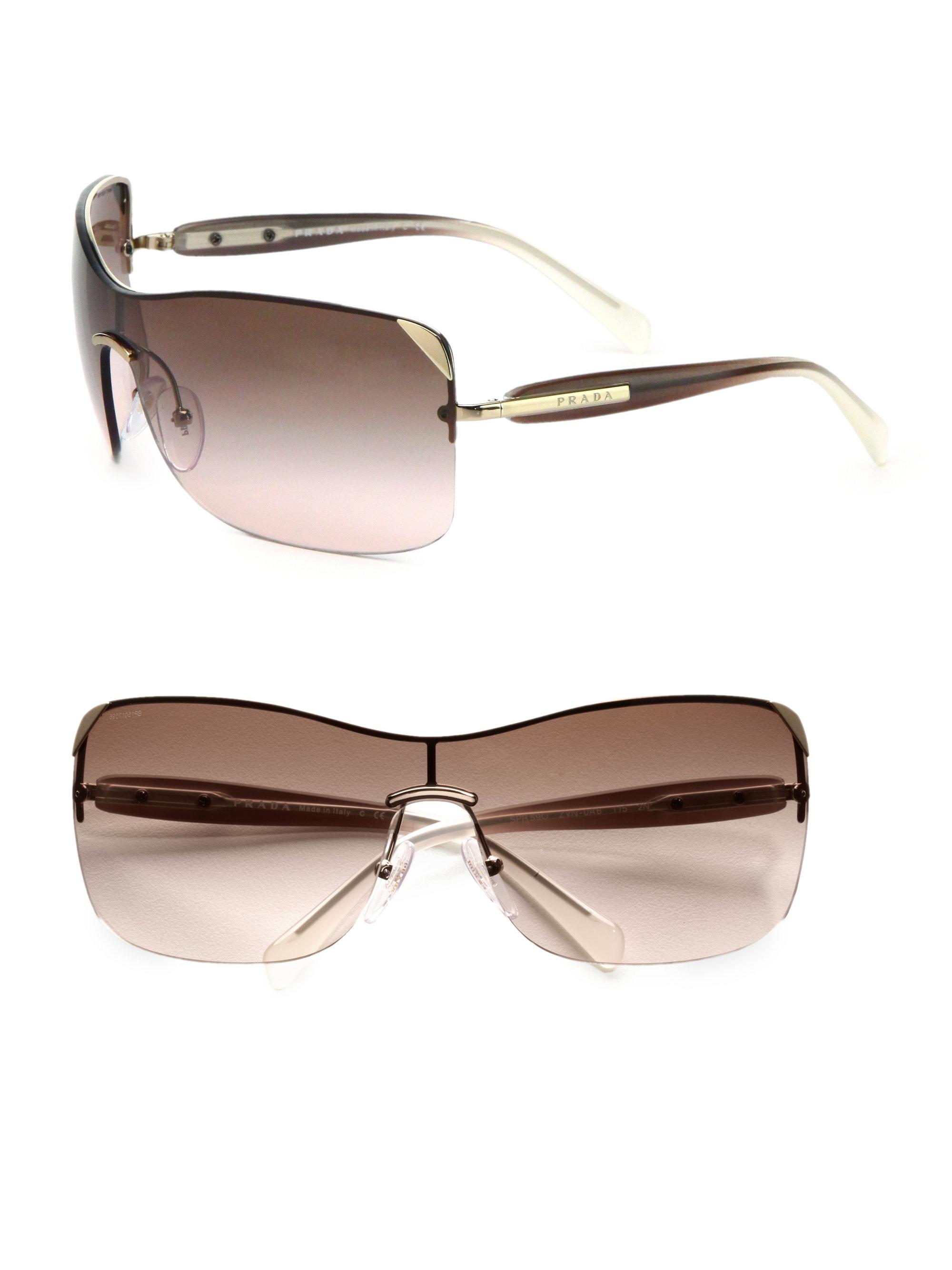 Prada Shield Sunglasses  prada rectangular rimless shield sunglasses in natural lyst