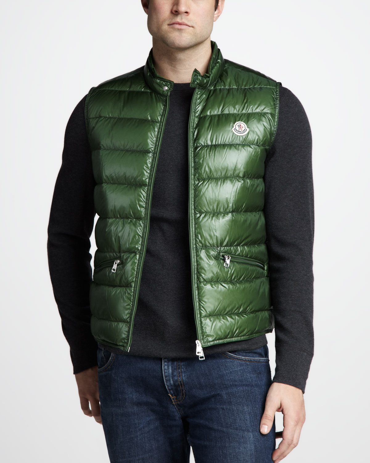 Men's emerald green full back dress vest with 5 buttons and 2 front pockets. % Polyester. Machine washable. Vest's front and back are of the same color and fabric.