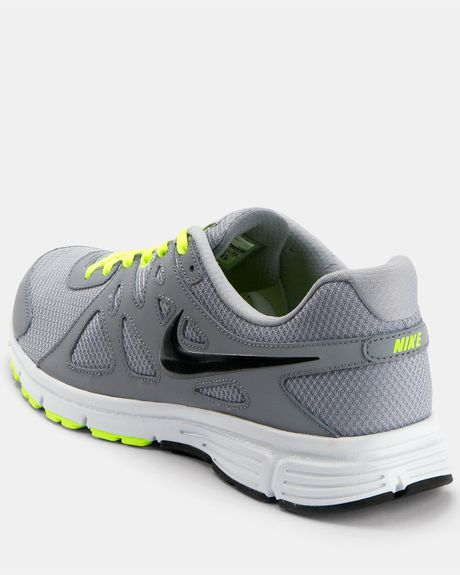 Nike Revolution Trainers in White for Men (grey/yellow) | Lyst