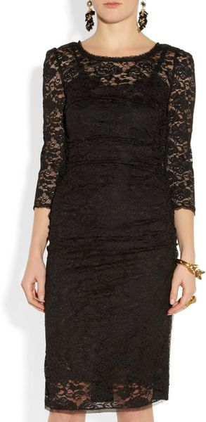 http://cdna.lystit.com/photos/2013/01/09/dolce-gabbana-black-ruched-lace-and-cady-dress-product-2-5985195-287654033_large_flex.jpeg