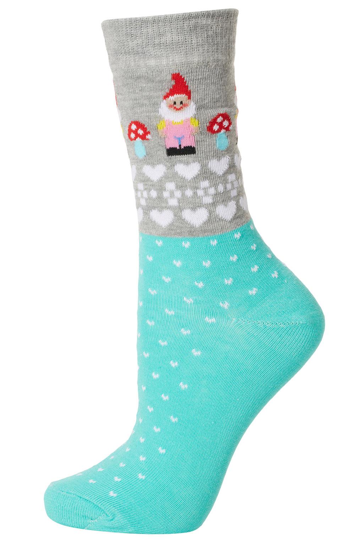 Lyst topshop green garden gnome socks in green for Garden socks