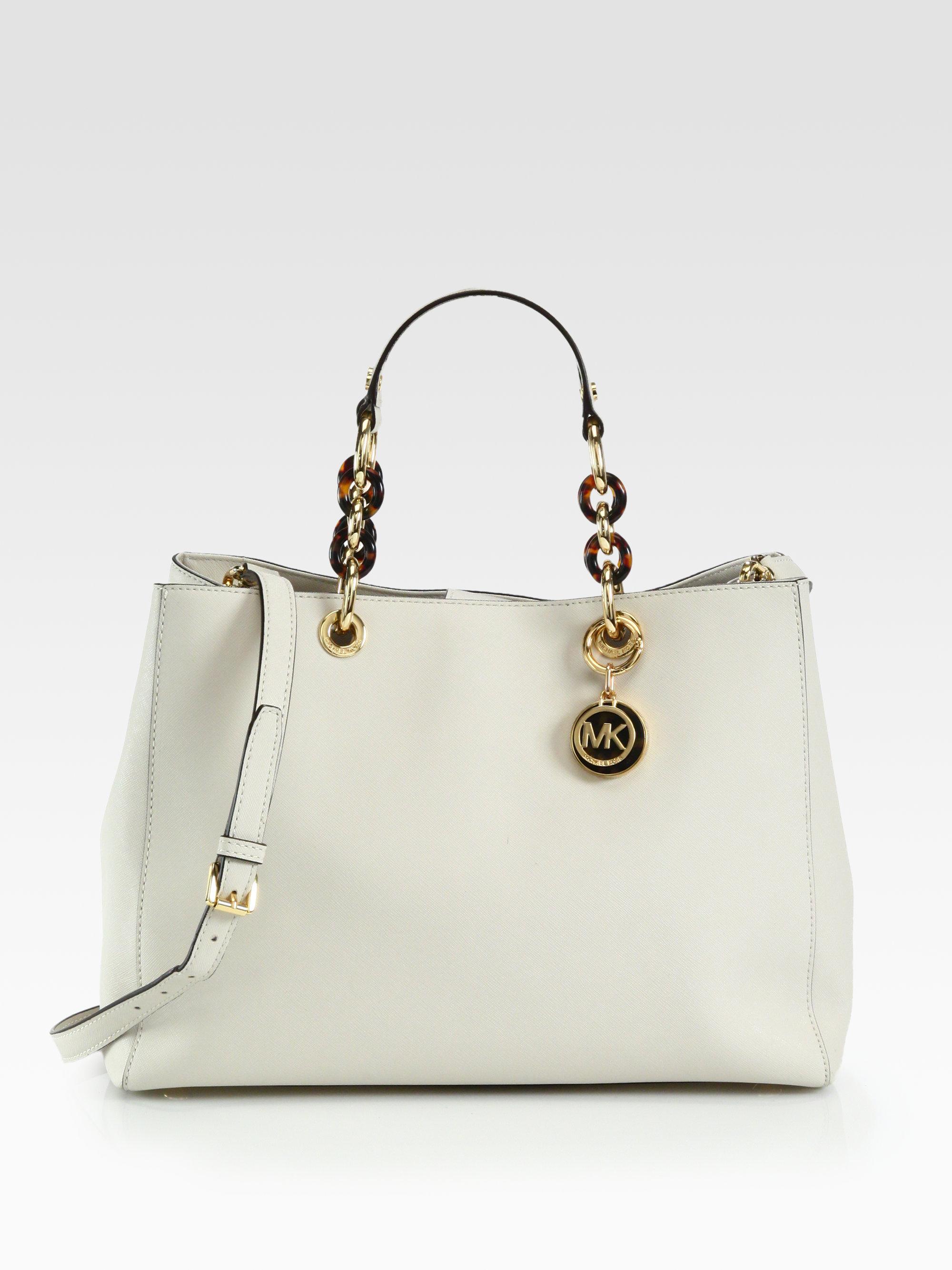 e29a5312ff38 ... shop lyst michael michael kors cynthia large satchel in natural e95df  a07be