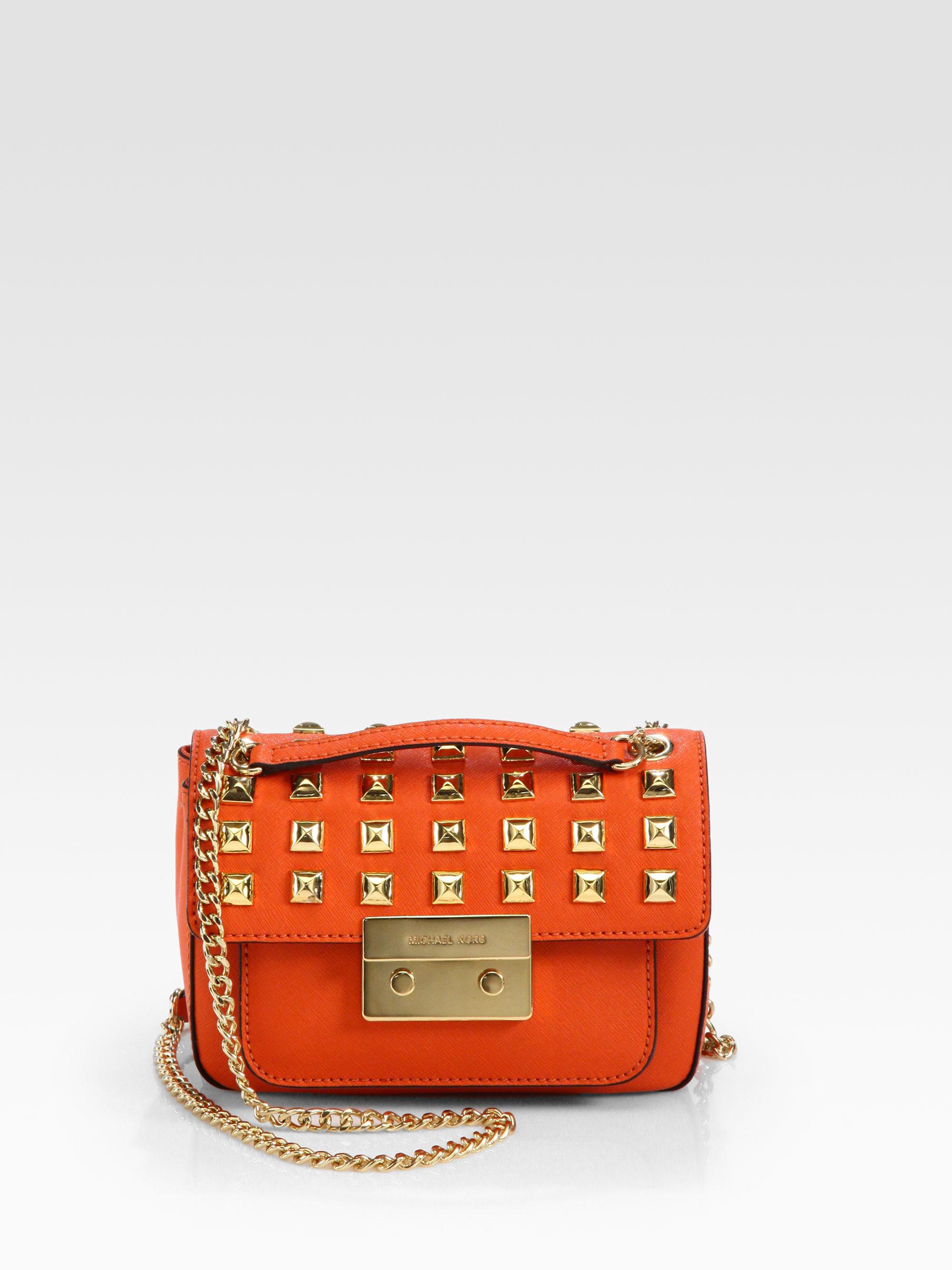 lyst michael michael kors sloan stud small shoulder flap bag in orange rh lyst com