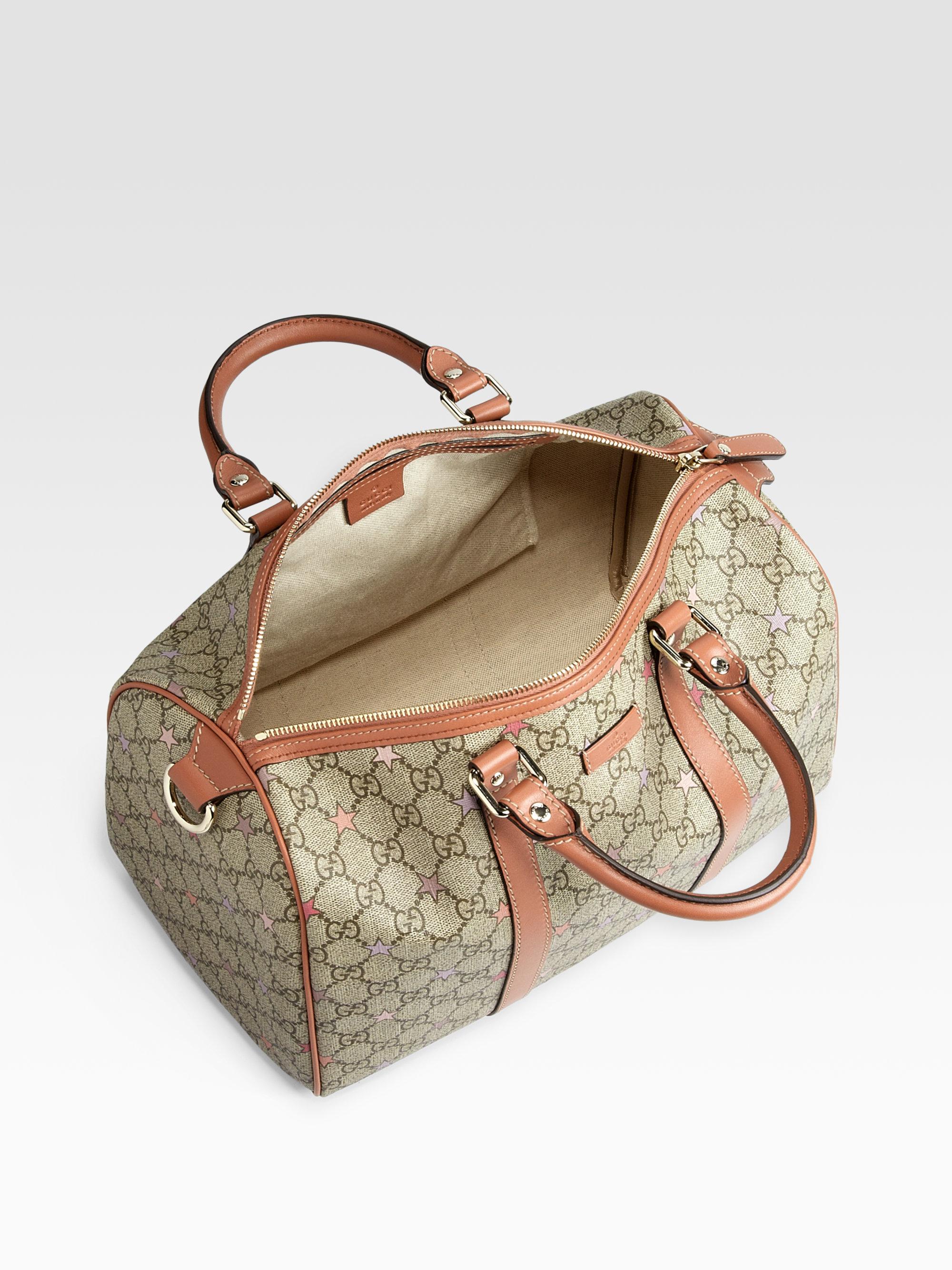 lyst gucci joy gg supreme stars canvas boston bag in natural