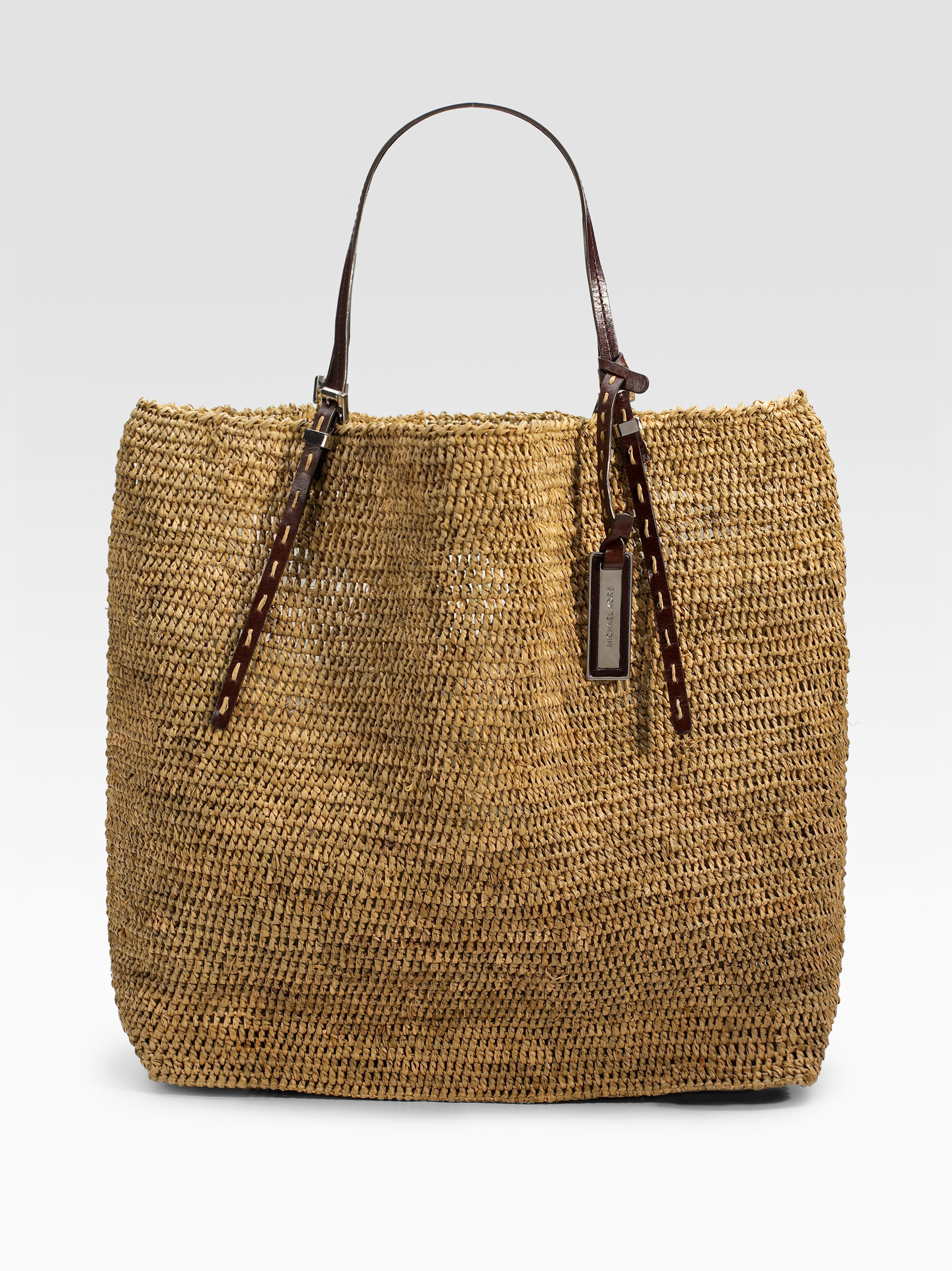 006ada82b83c germany pre owned at therealreal michael michael kors leather trimmed  raffia tote cf6eb cf48c  cheap lyst michael kors santorini large raffia tote  in brown ...