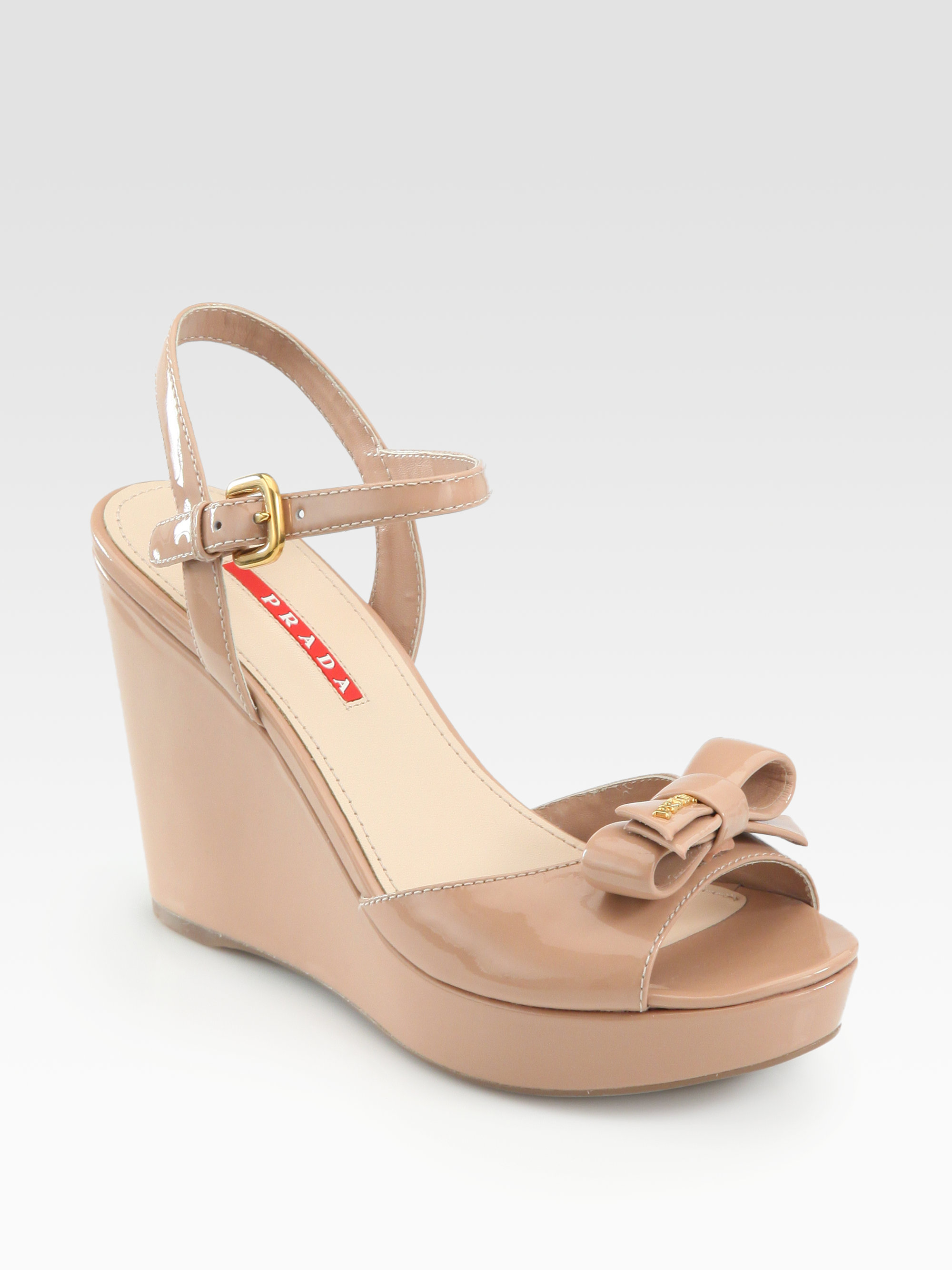 ca91290c866 Lyst - Prada Patent Leather Bow Wedge Sandals in Natural