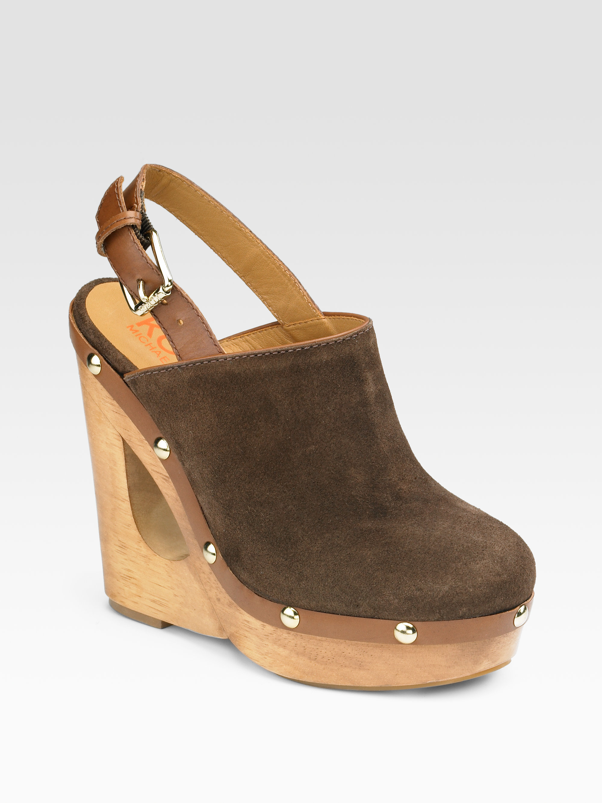 kors by michael kors harbor suede cutout wedge clogs in