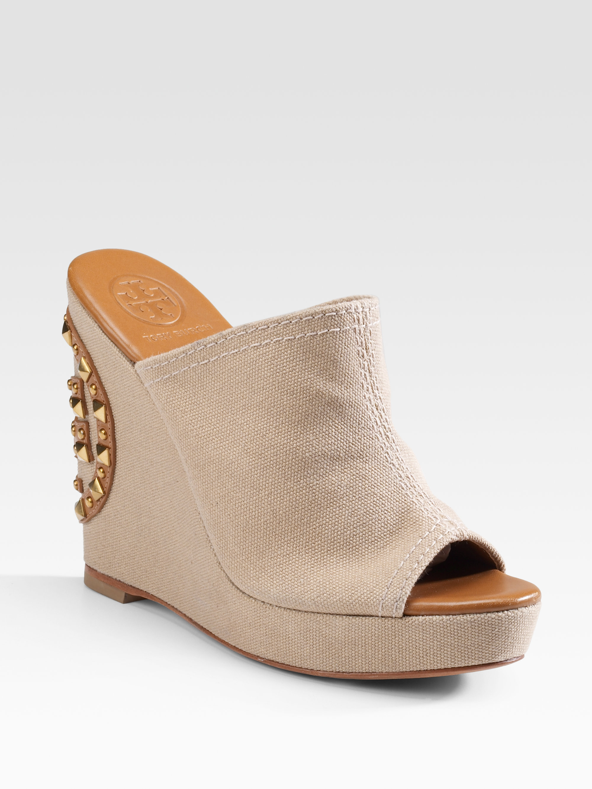 31e09cc19e5 Lyst - Tory Burch Meredith Canvas Wedge Slides in Natural