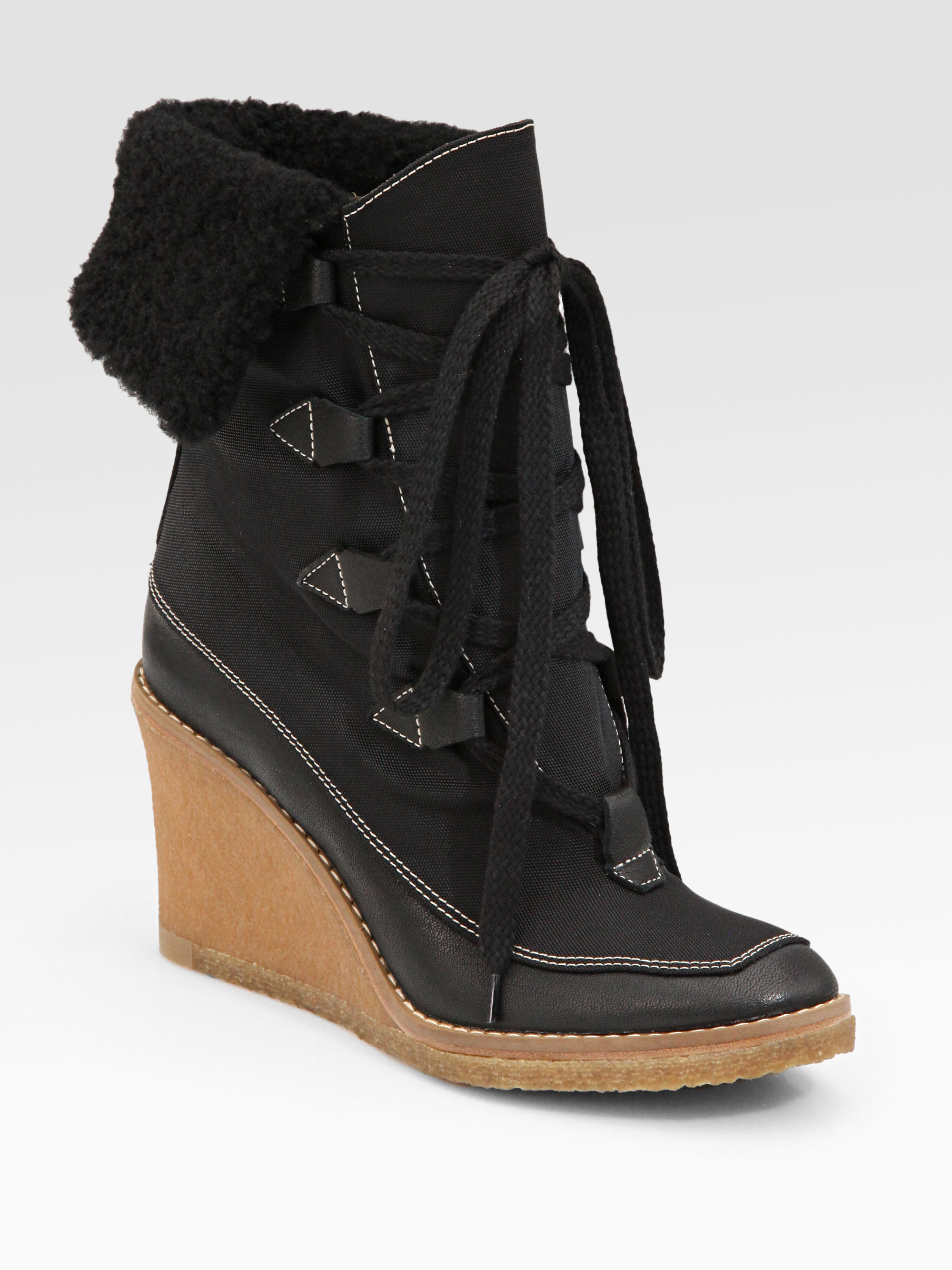 chlo 233 lace up shearling wedge ankle boots in black lyst