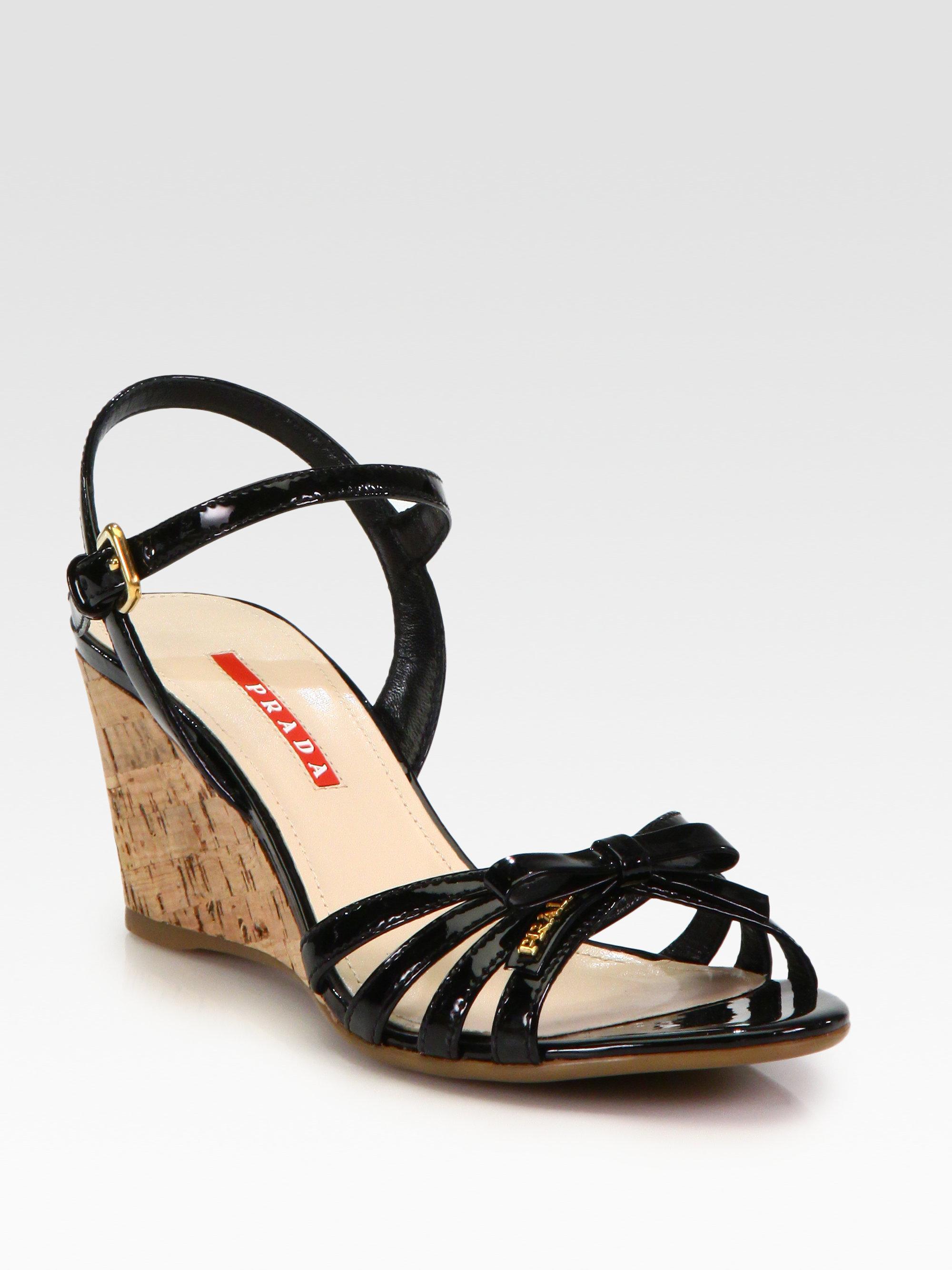 4ad1359b164 Lyst - Prada Leather Bow Cork Wedge Sandals in Black