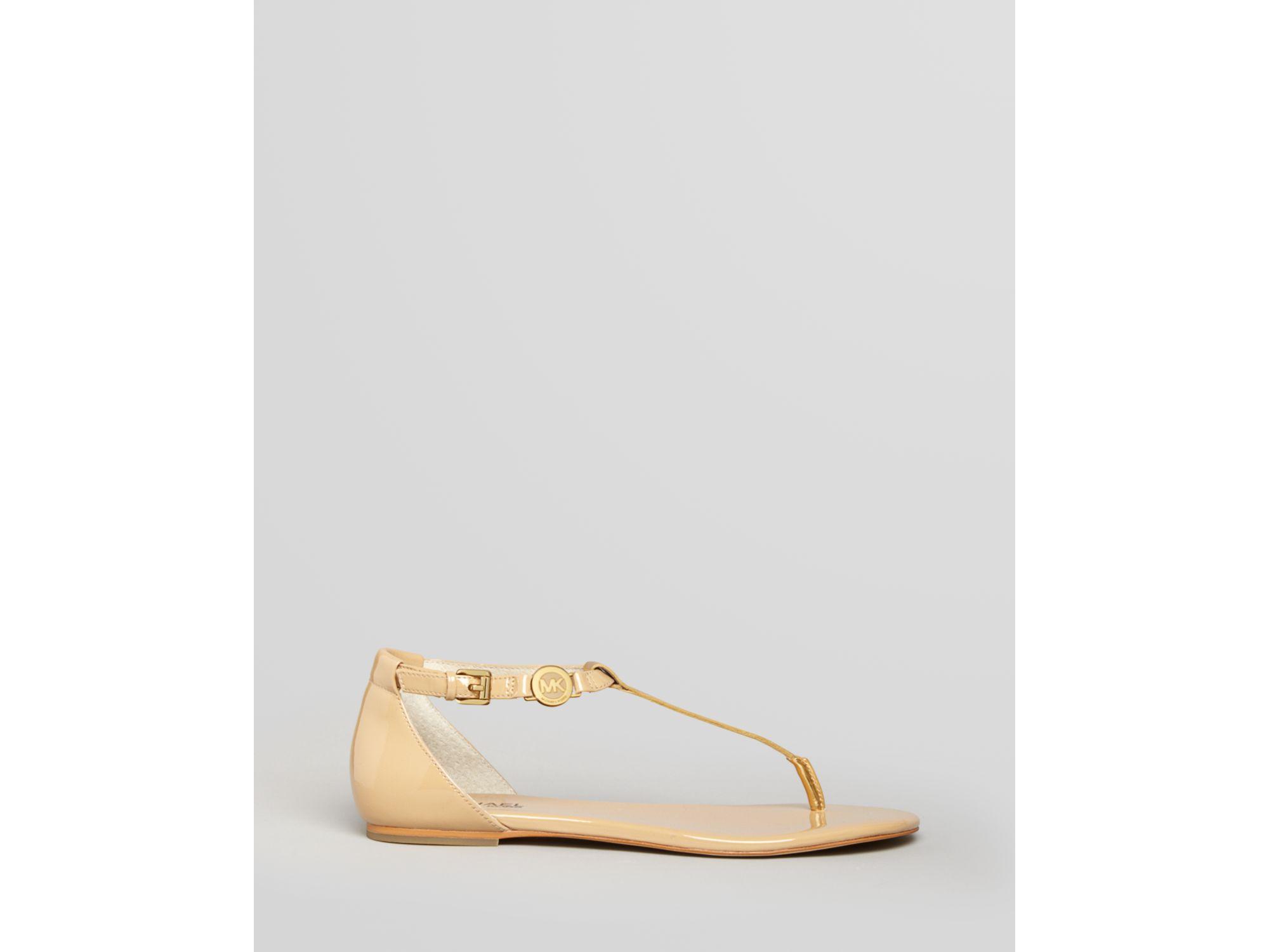 c0b068ccfa0df Lyst - MICHAEL Michael Kors Flat Thong Sandals Bridget in Natural