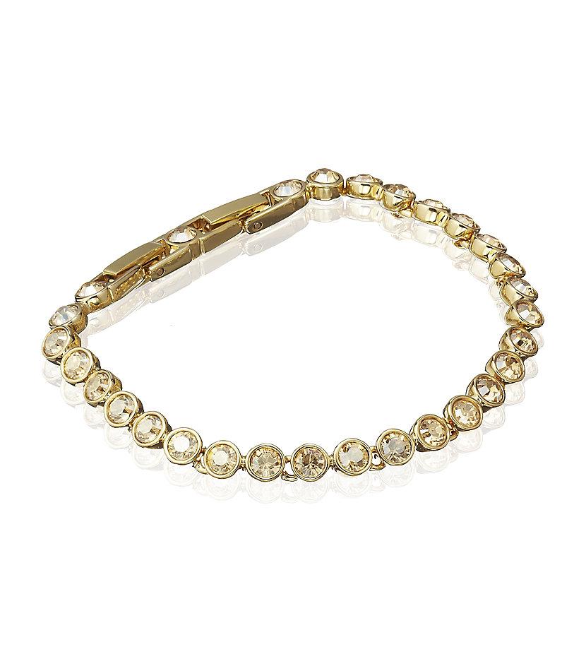 swarovski golden shadow tennis bracelet in gold lyst. Black Bedroom Furniture Sets. Home Design Ideas