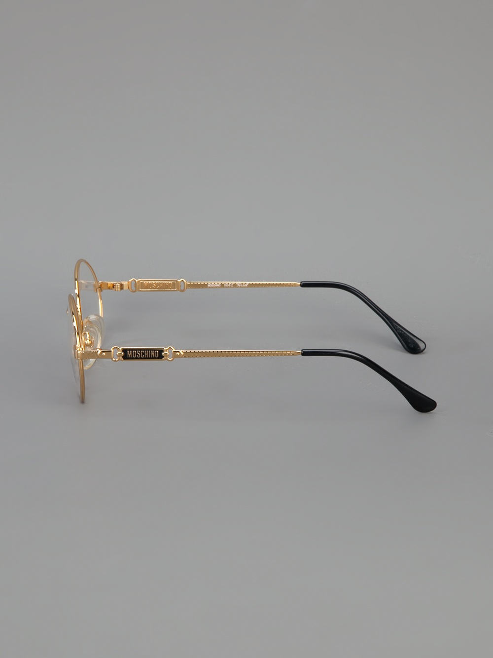 Lyst Moschino Round Frame Glasses In Metallic