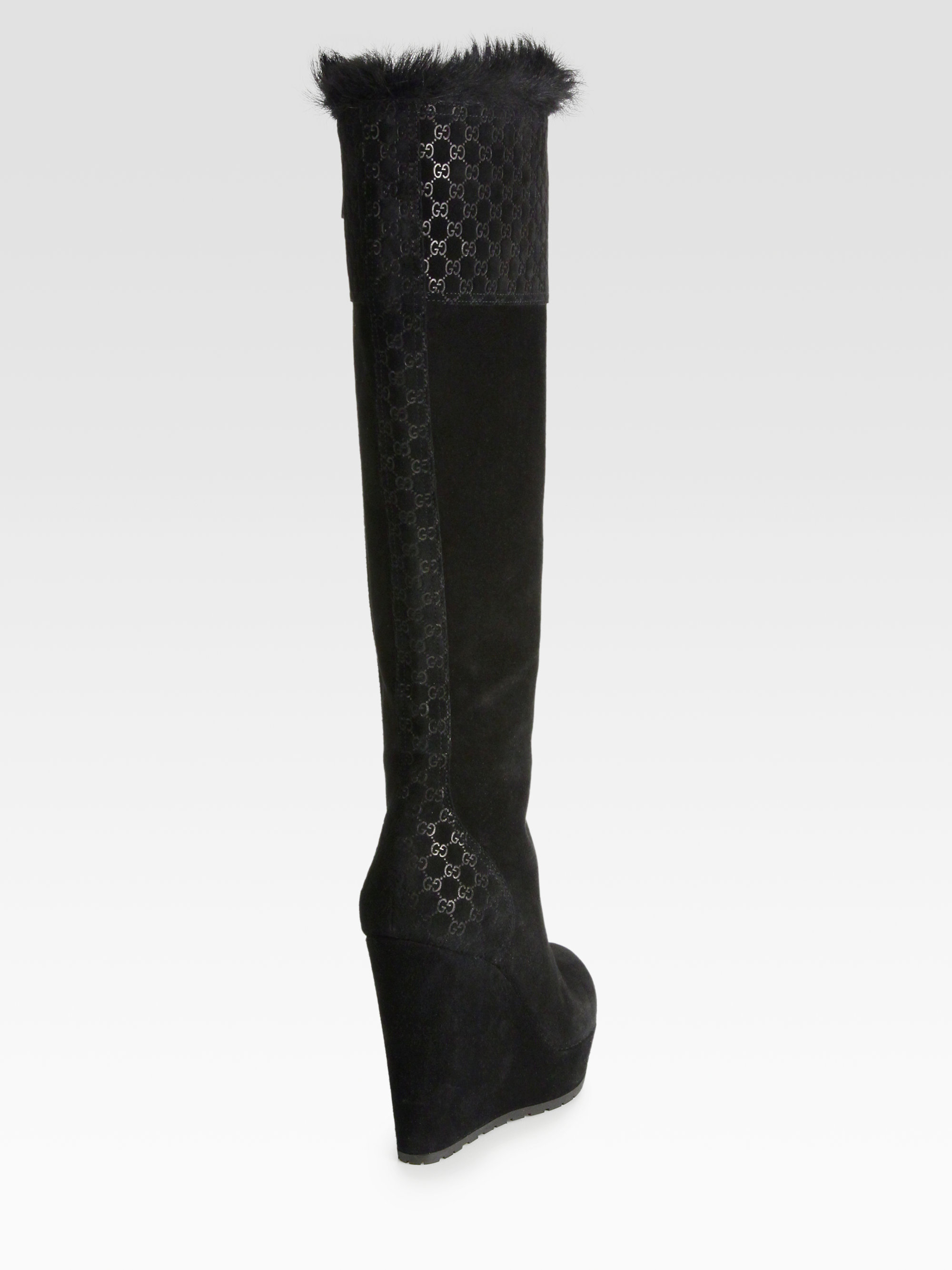 c1c6f357112 Lyst - Gucci Gg Suede Furlined Wedge Boots in Black