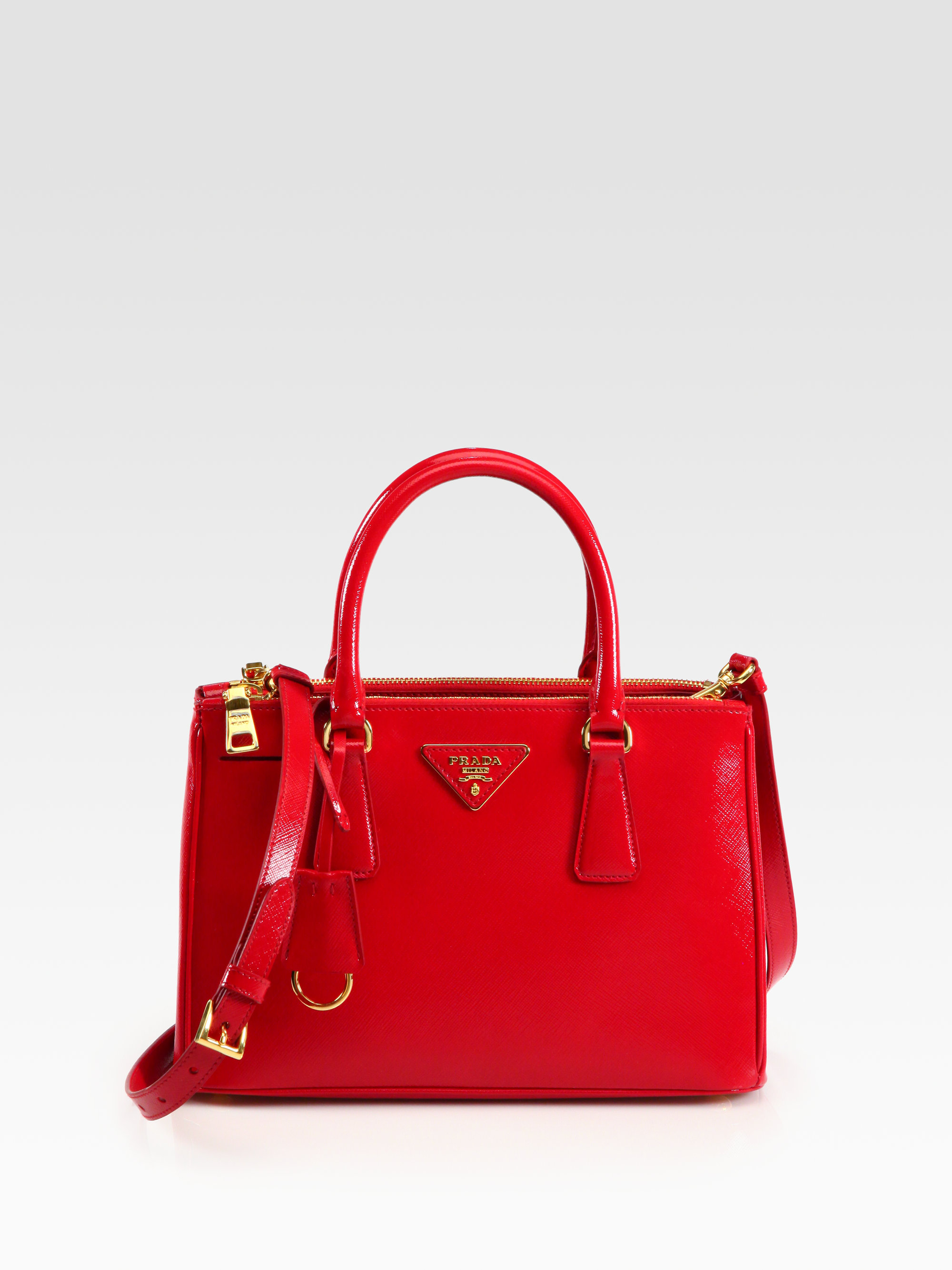 f46cf54a3b5f ... where to buy lyst prada saffiano vernice tote in red 9d4e6 98a25