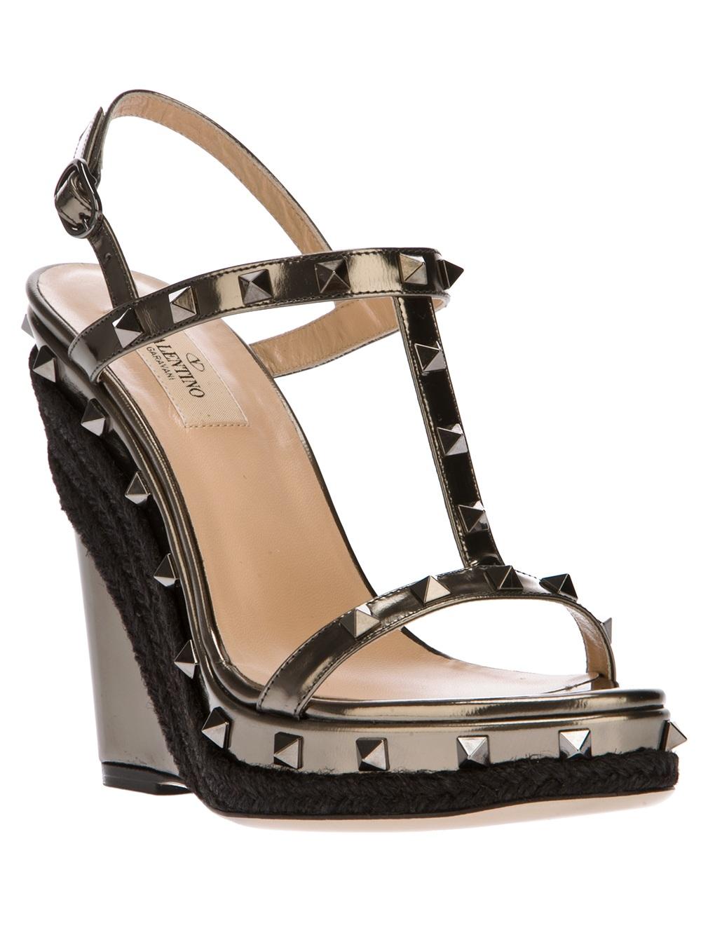 a5123d7bcdb3 Lyst - Valentino Rockstud Wedge Sandal in Brown