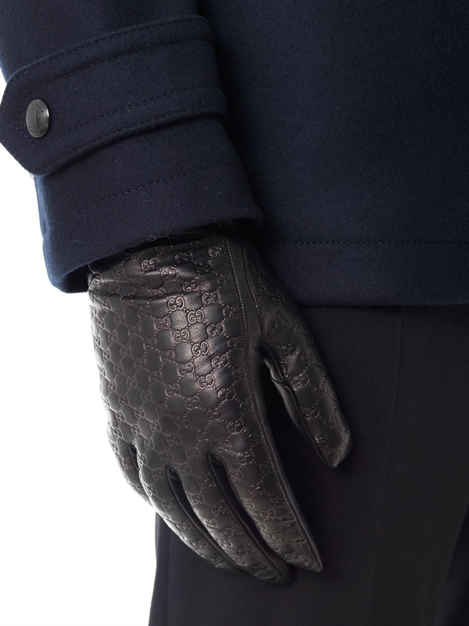 79dcfb6ee Gucci Black Logo Embossed Leather Gloves for men