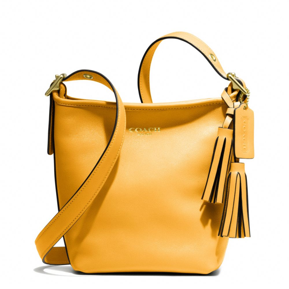 a823b548d1f4 Lyst - COACH Legacy Leather Minnie Duffle in Yellow