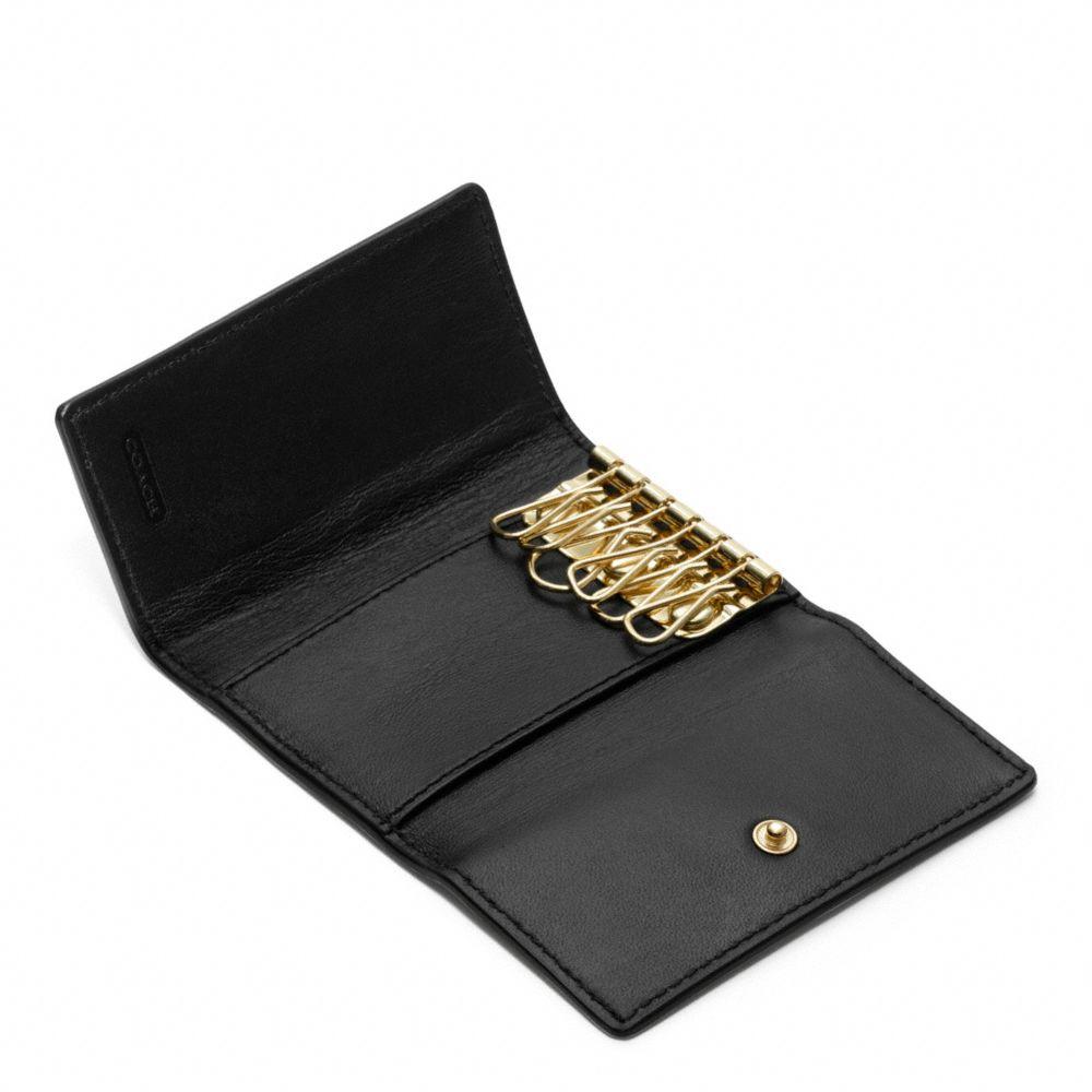 e89772a96c COACH Black Six Ring Key Case in Saffiano Leather