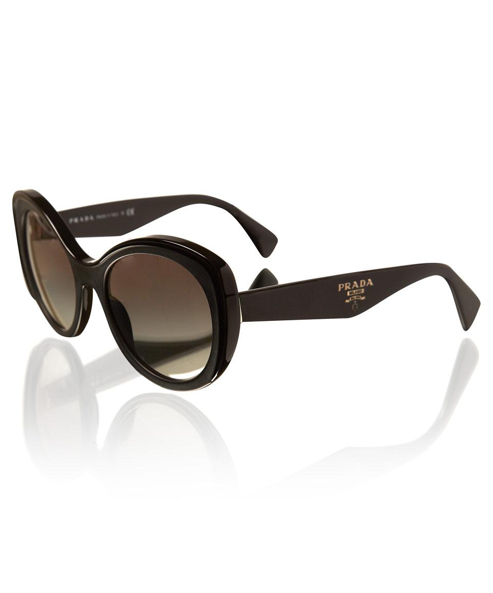 bc3c1e9b8d82 ... new style lyst prada black oversized curvy cat eye sunglasses in black  0d79a 581ec