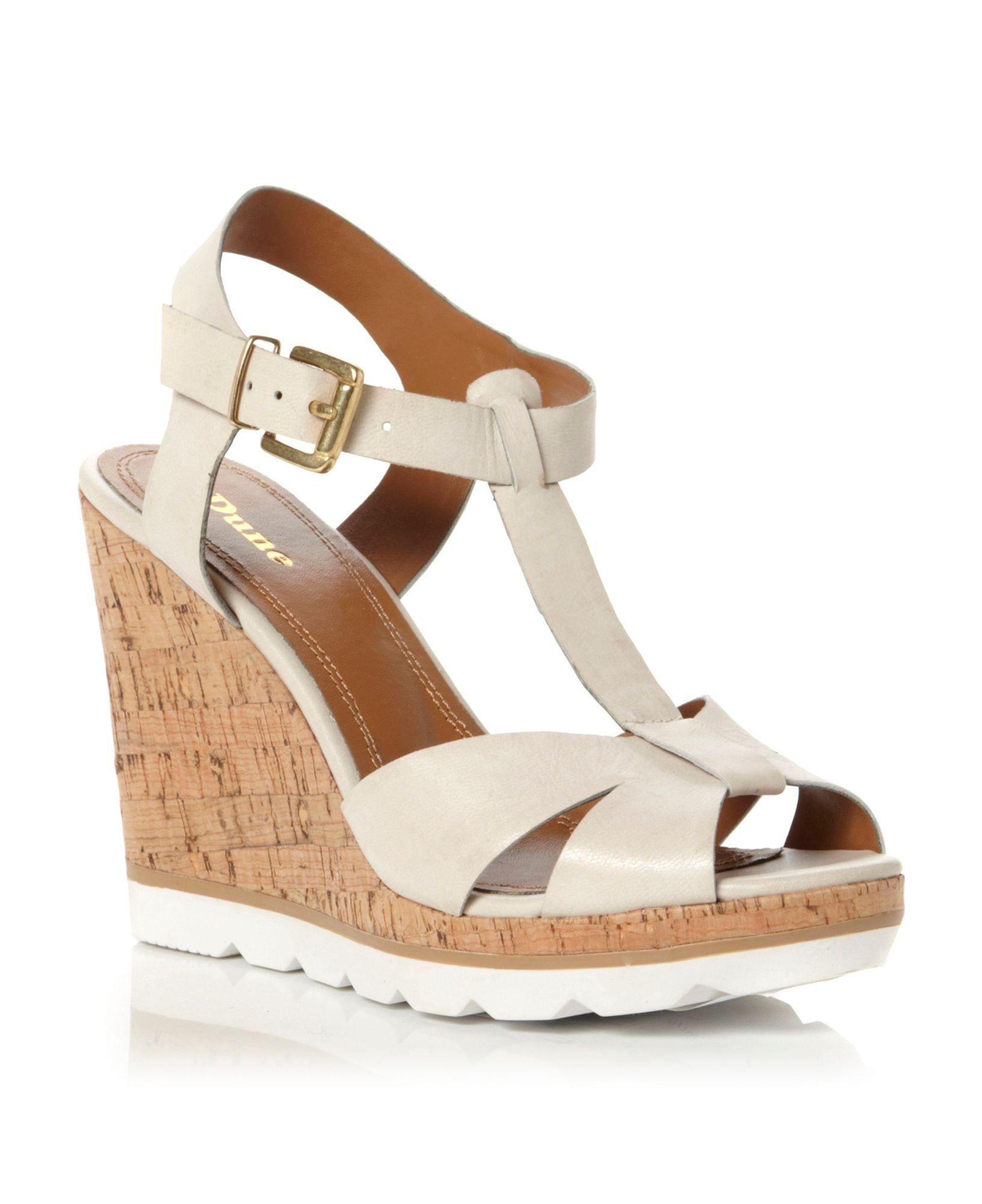 dune giraffe tbar wedge shoes in white white lyst