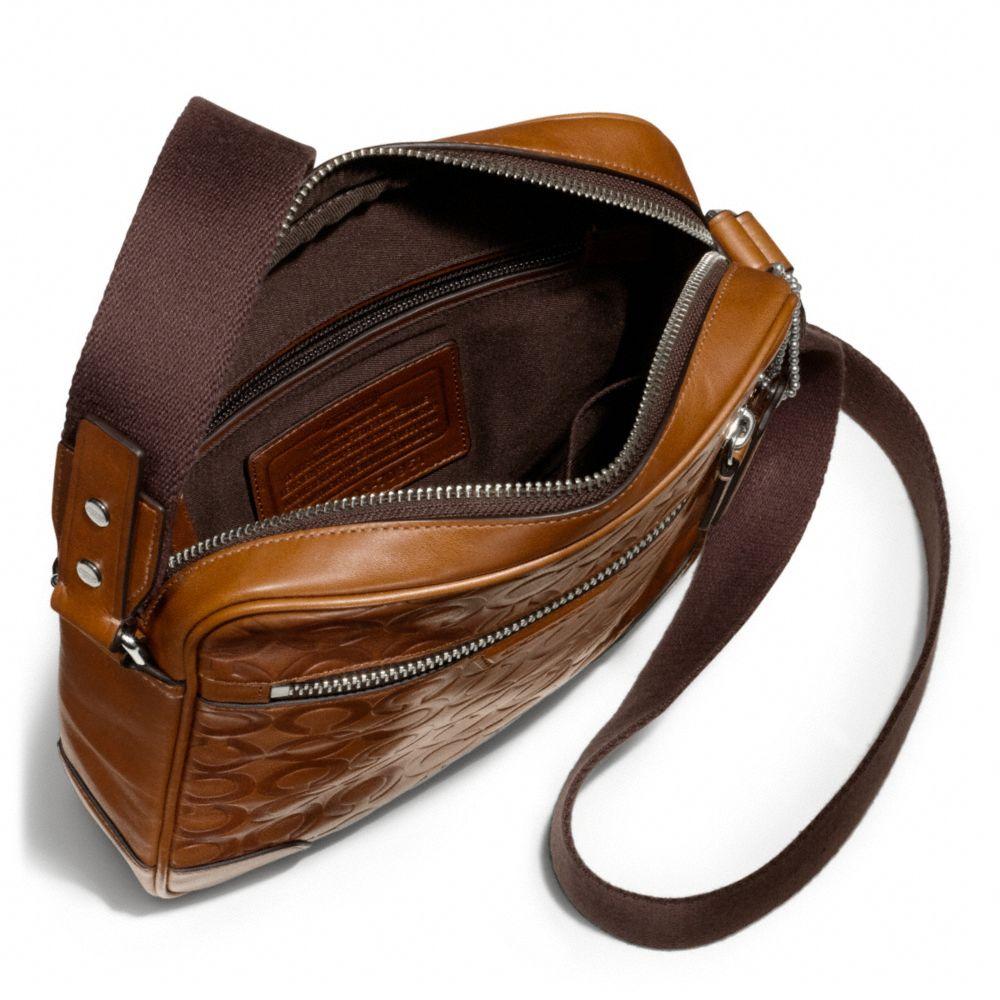 104d9425b1 ... australia lyst coach bleecker large flight bag in op art embossed  leather in d7c13 6640a